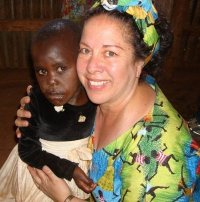 Gloria Cooper in Africa with child
