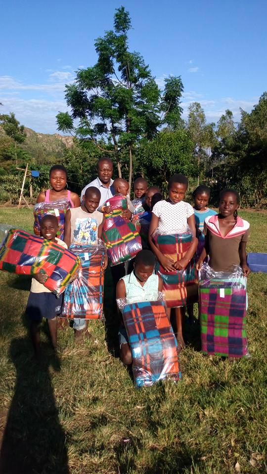 African Children receiving blankets from H2H