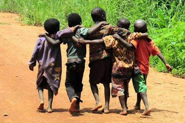 African children with arms around eachother