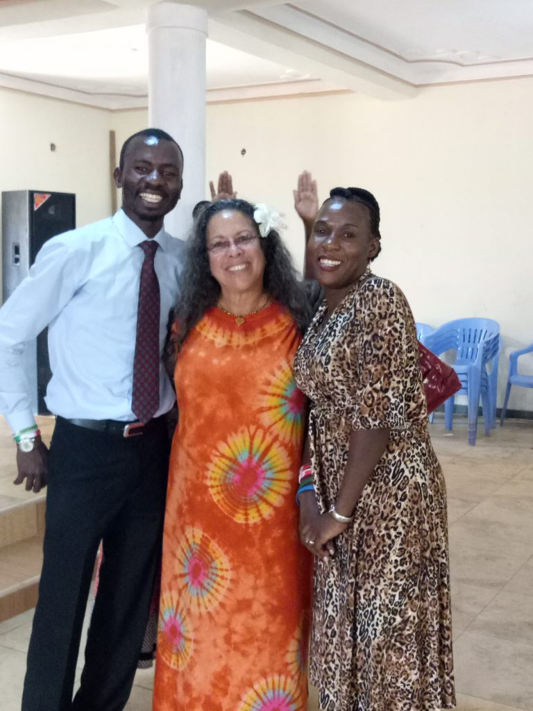 Gloria Cooper with Franklyn and Sarah Kasozi