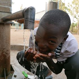 African child drinking water