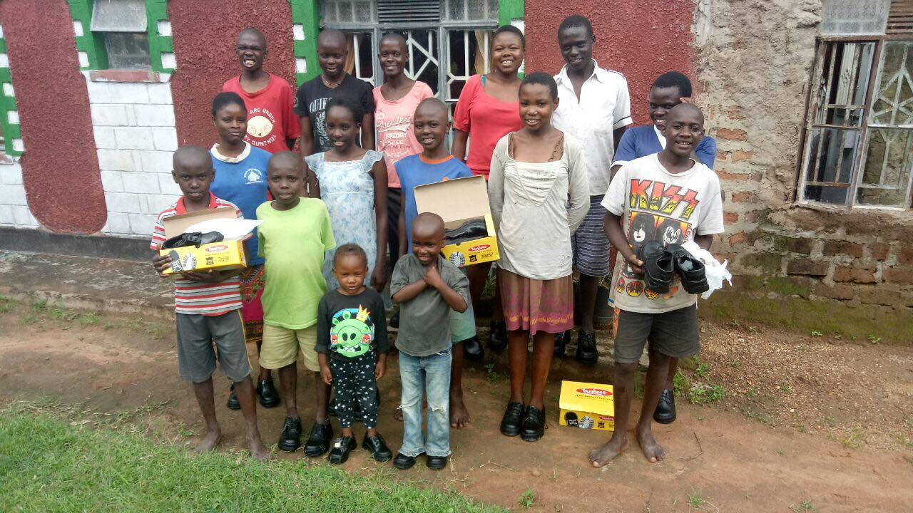 African children in Kenya receiving shoes donated by H2H