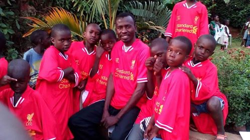 Franklyn with kids playing soccer