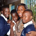Sarah with students in Uganda Africa