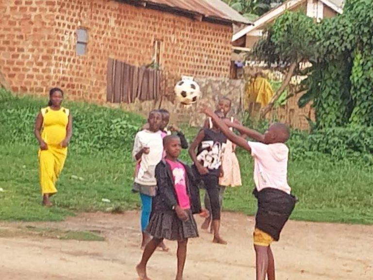 kids in Uganda playing soccer