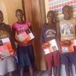 children holding books in africa